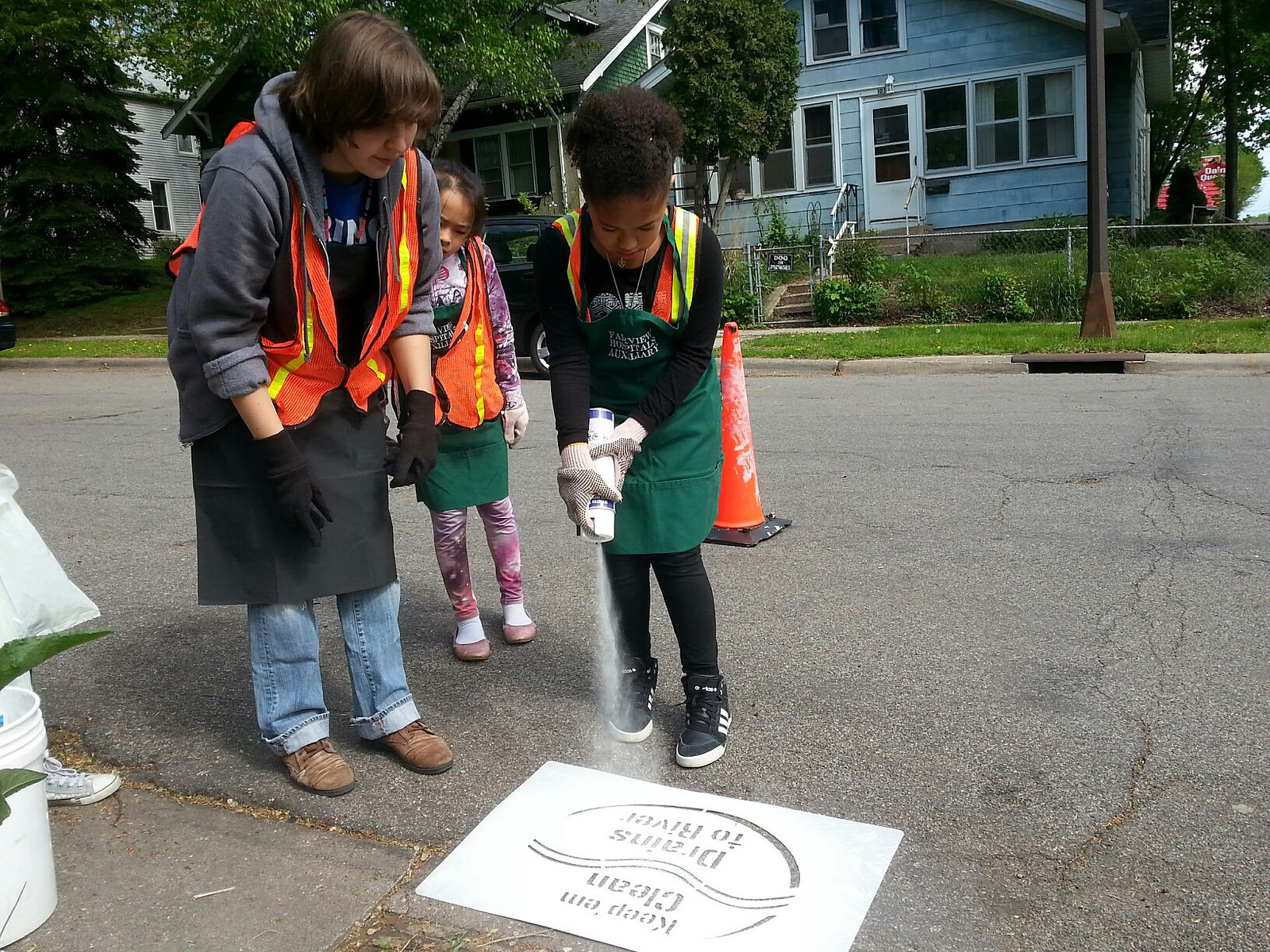 Let's spray paint storm drains for the Mighty Mississippi!