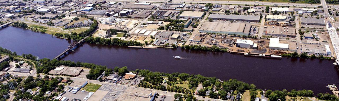 A little more green, please — for our waters and our riverfront communities. (Aerial view, from the north, above Saint Anthony Falls.) Courtesy City of Minneapolis