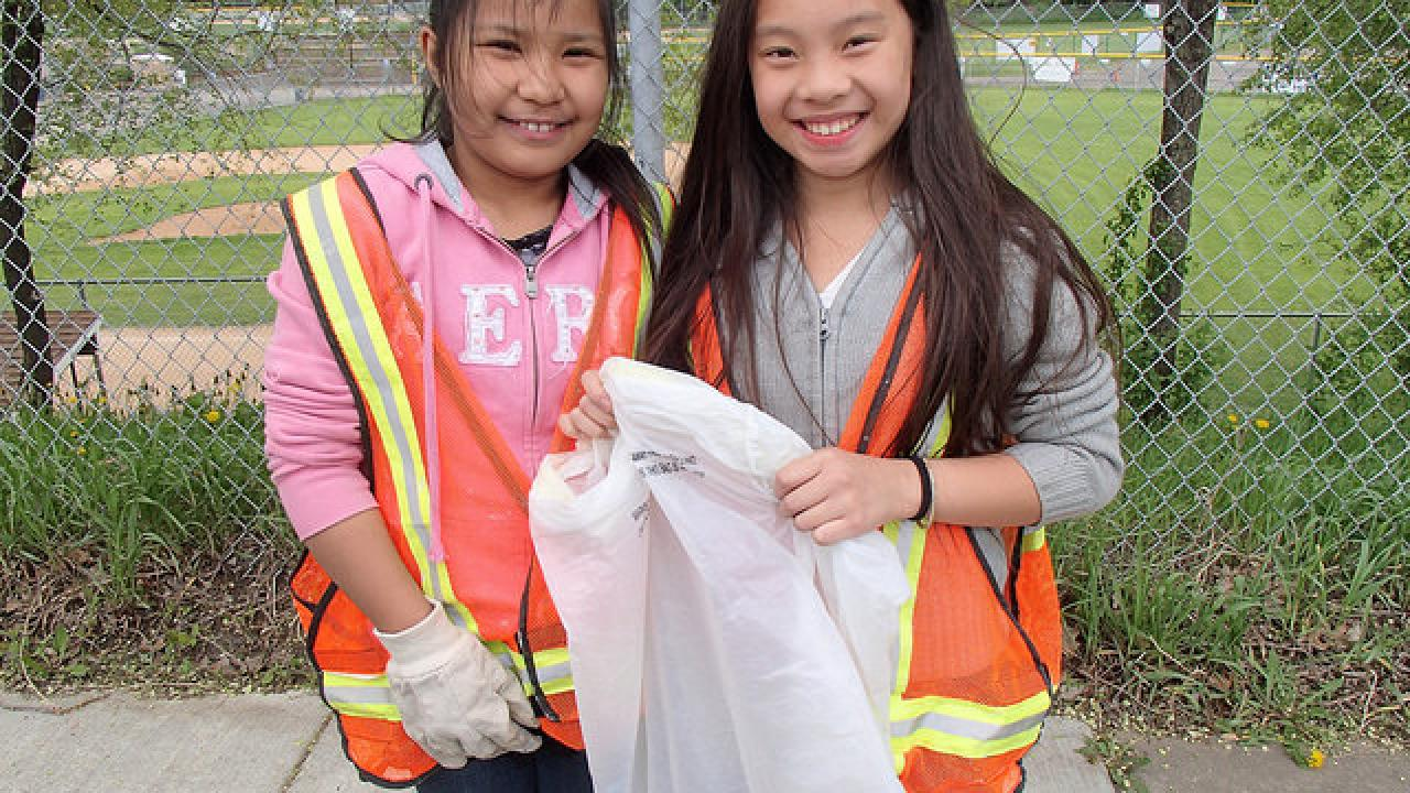American Indian Magnet School students help with a cleanup