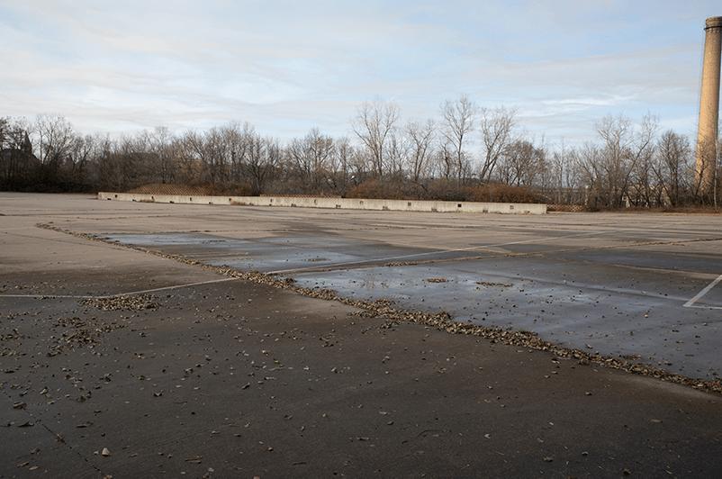 Parking lot looking concrete pad.