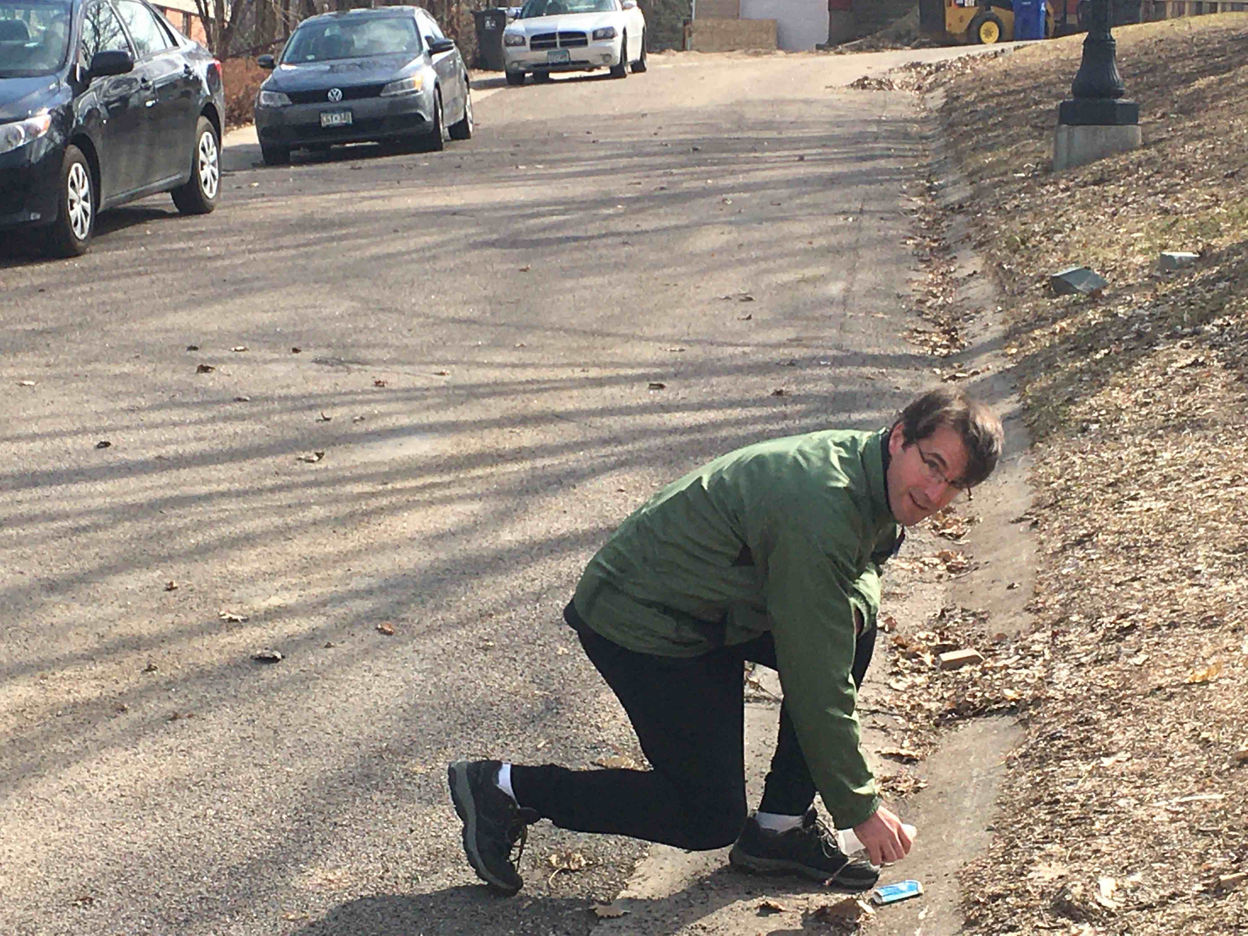 Friend of the river Josh Davis picks up trash on his street