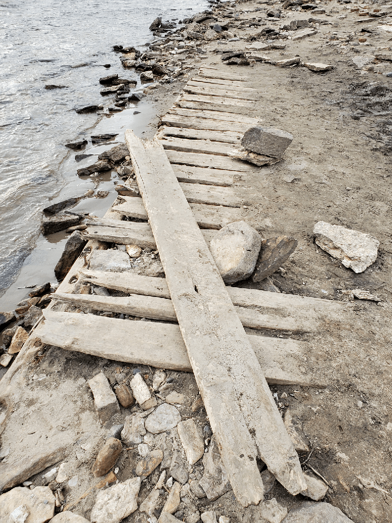 Exposed old planks and rocks