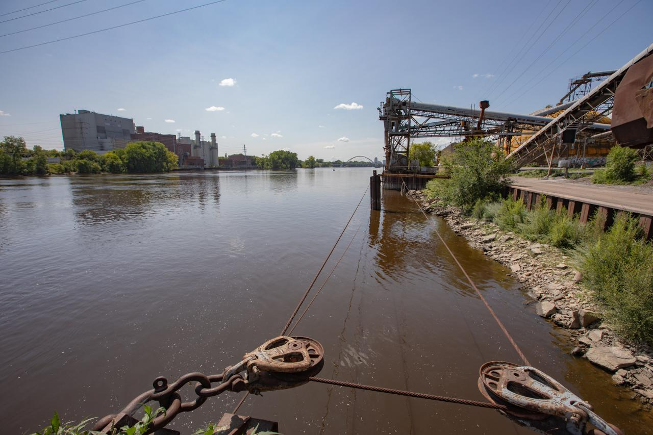 A river, with industrial structures on both shorelines.