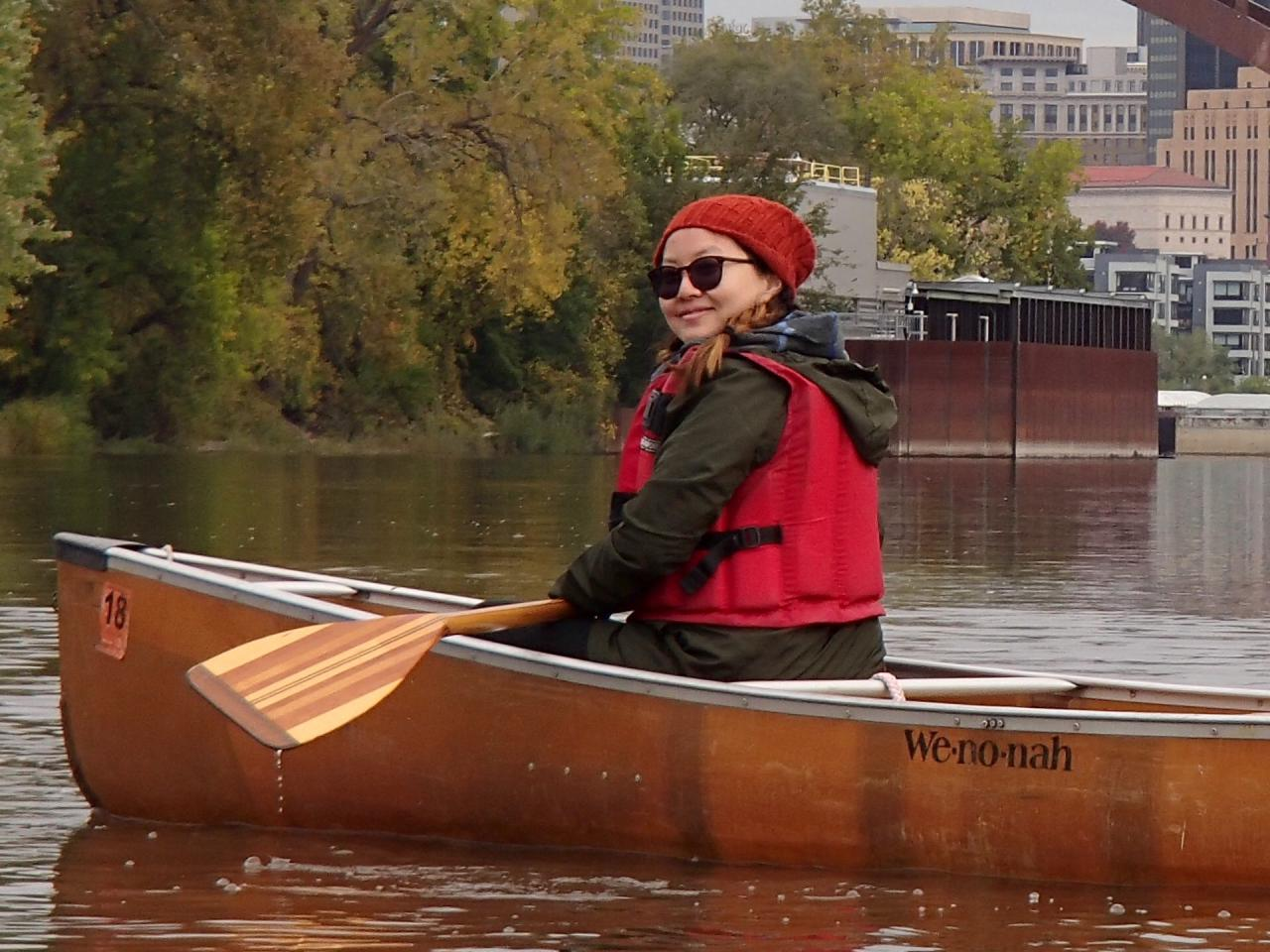 Linda Moua paddling the Mississippi River