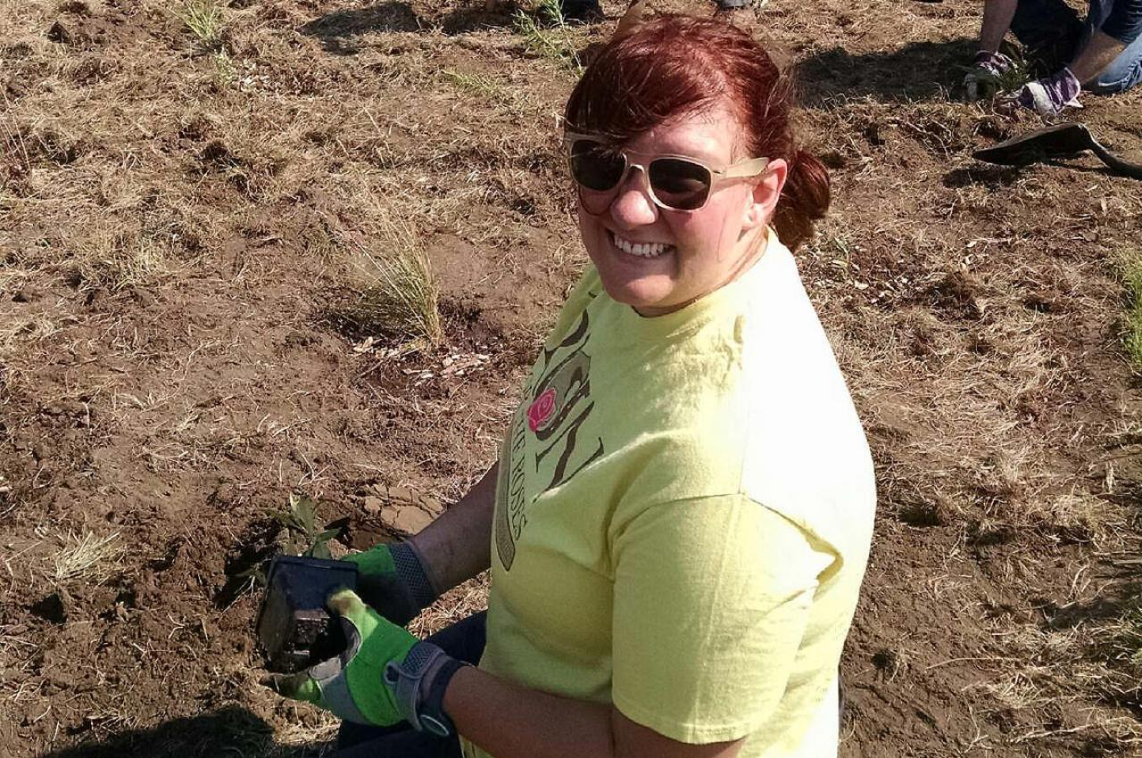An FMR Vermillion Stewards volunteer plants a pollinator patch.