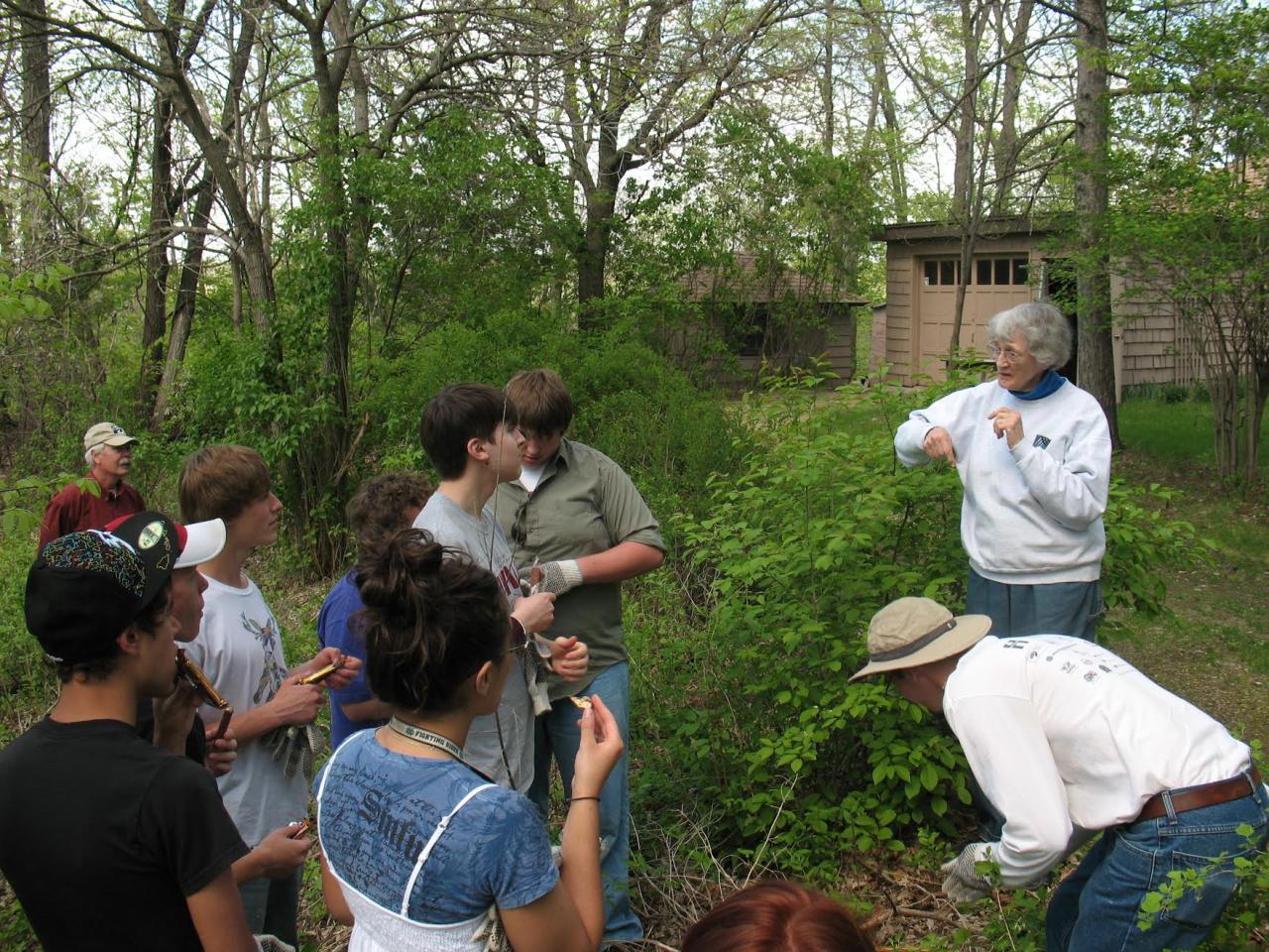 "Tecla Karpen and students in ""Karpen Woods"""