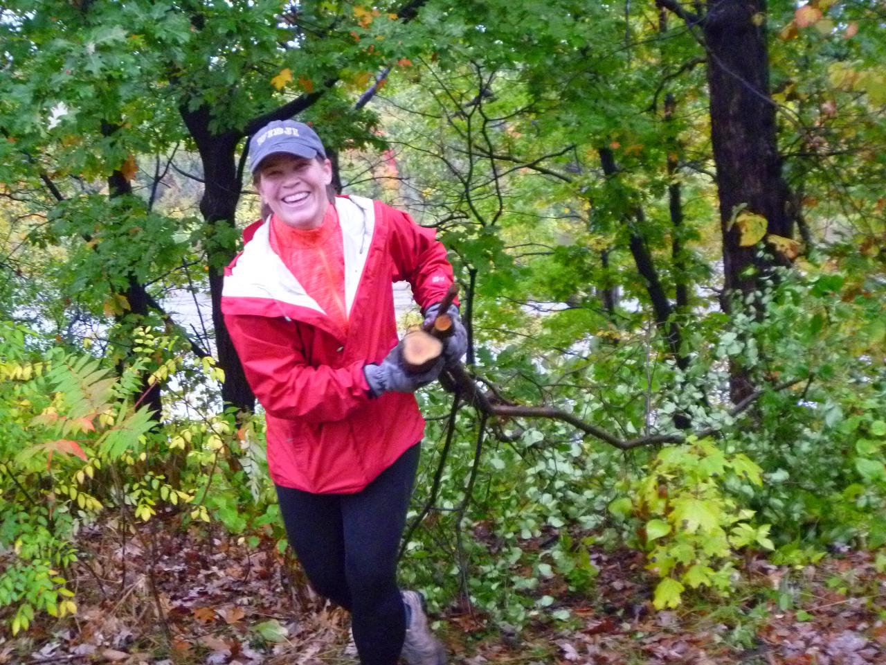 A volunteer hauls buckthorn in the river gorge