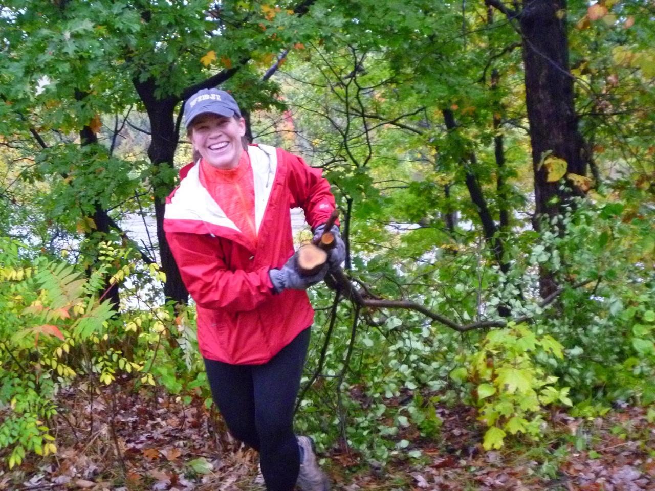 A volunteer hauls buckthorn in the river gorge