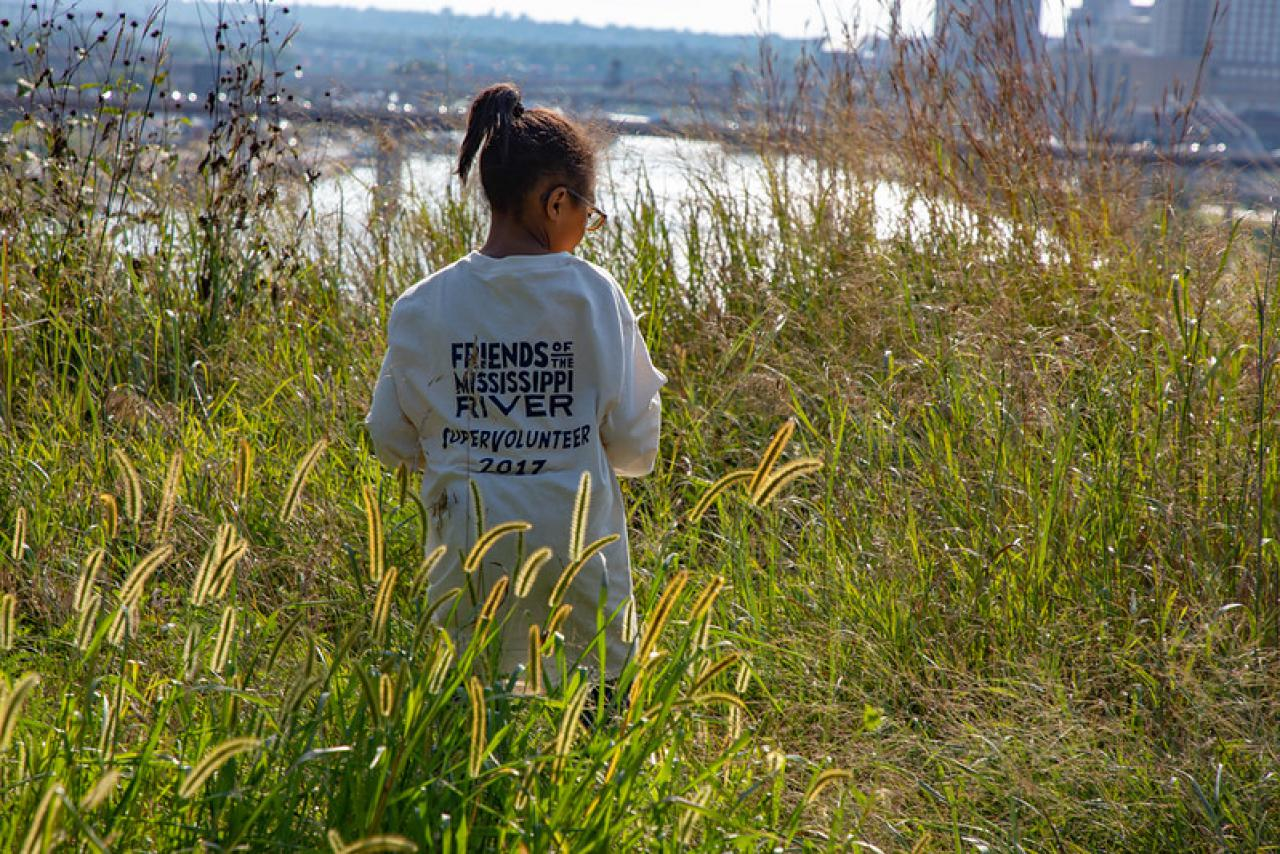 A young volunteer on the bluff at Indian Mounds Park
