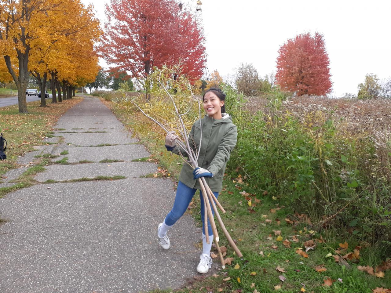 A student from Harding High Earth Club at the prairie at Mounds Park