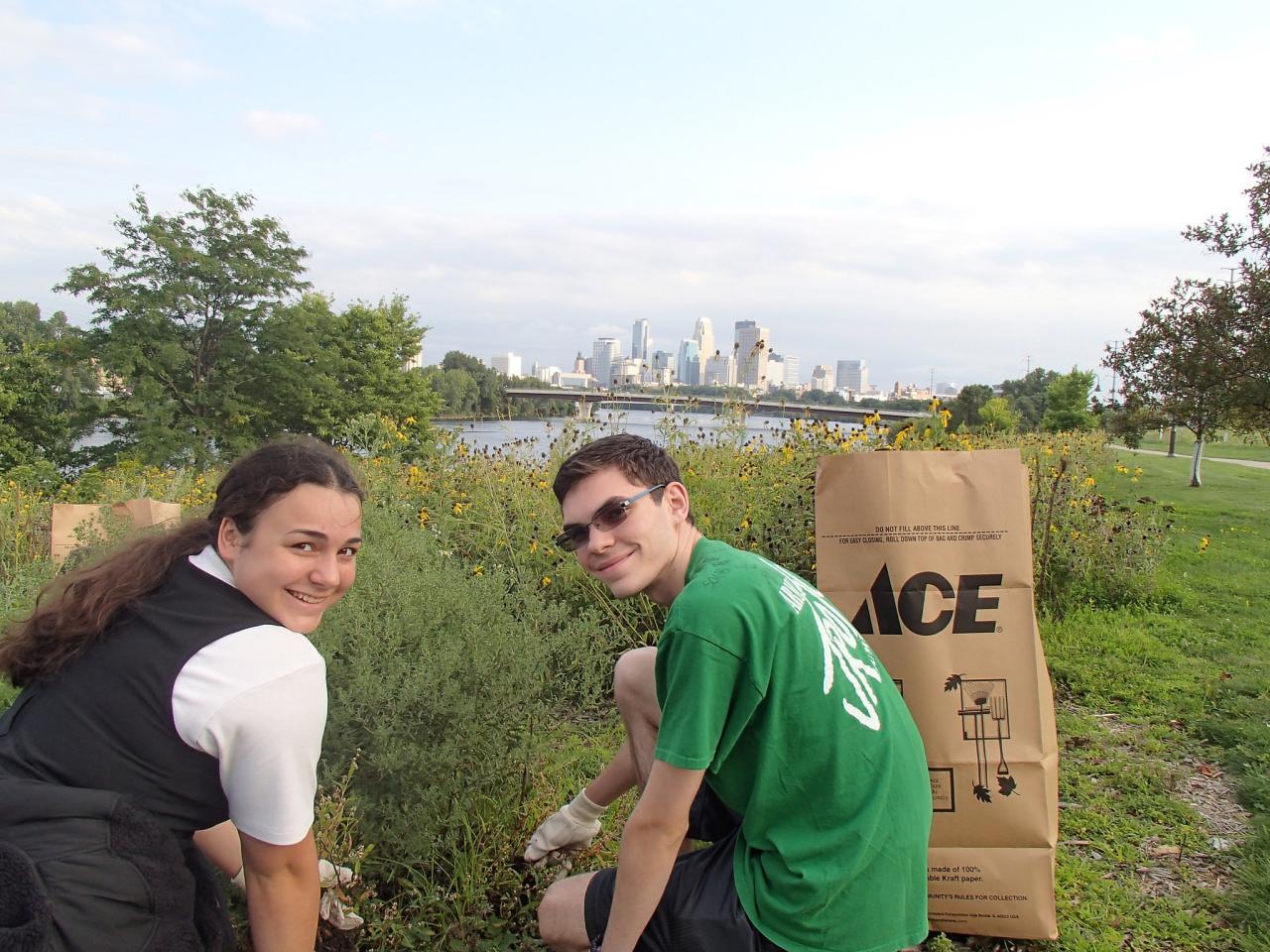 Two volunteers tending the prairie at Ole Olson Park in north Minneapolis