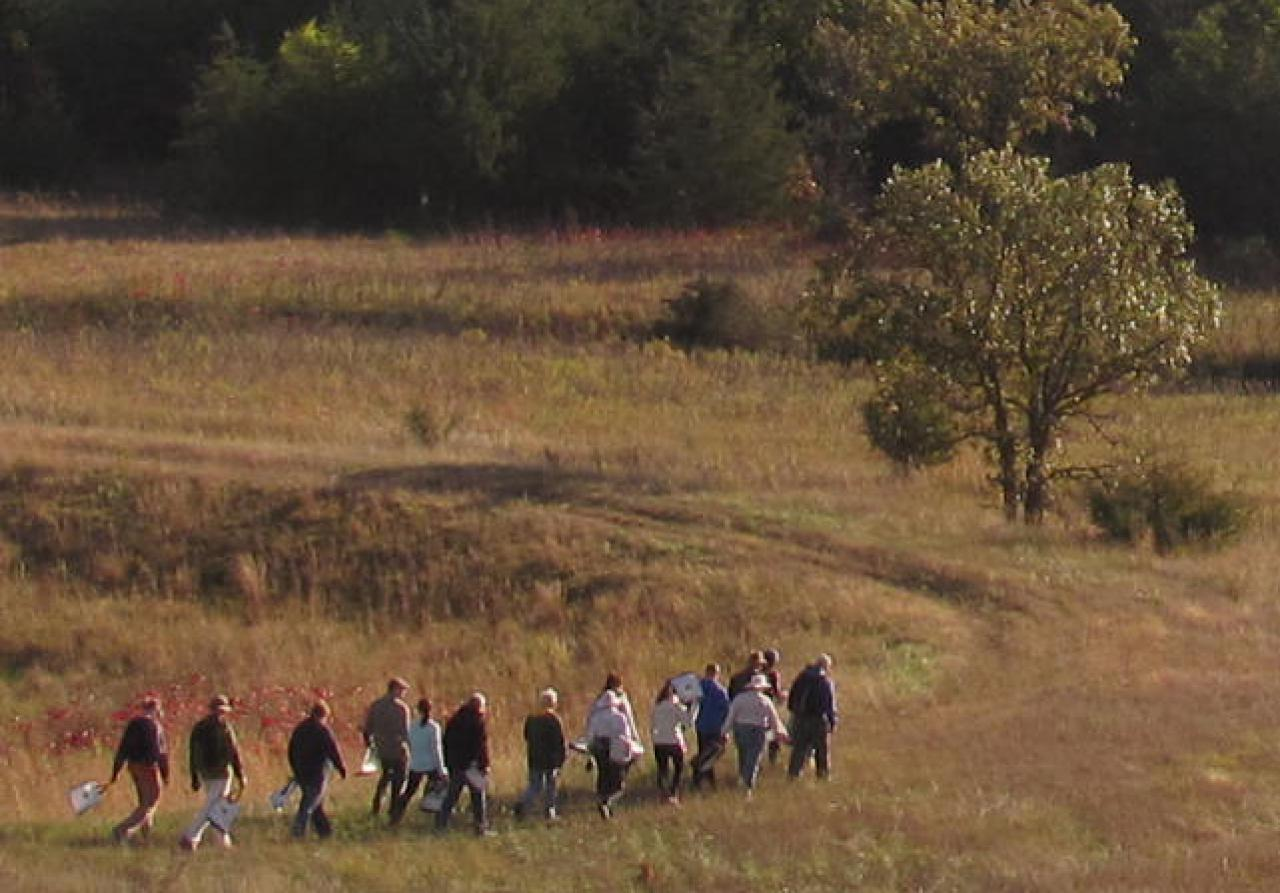 Volunteers proceed into the serene fall sand coulee landscape.