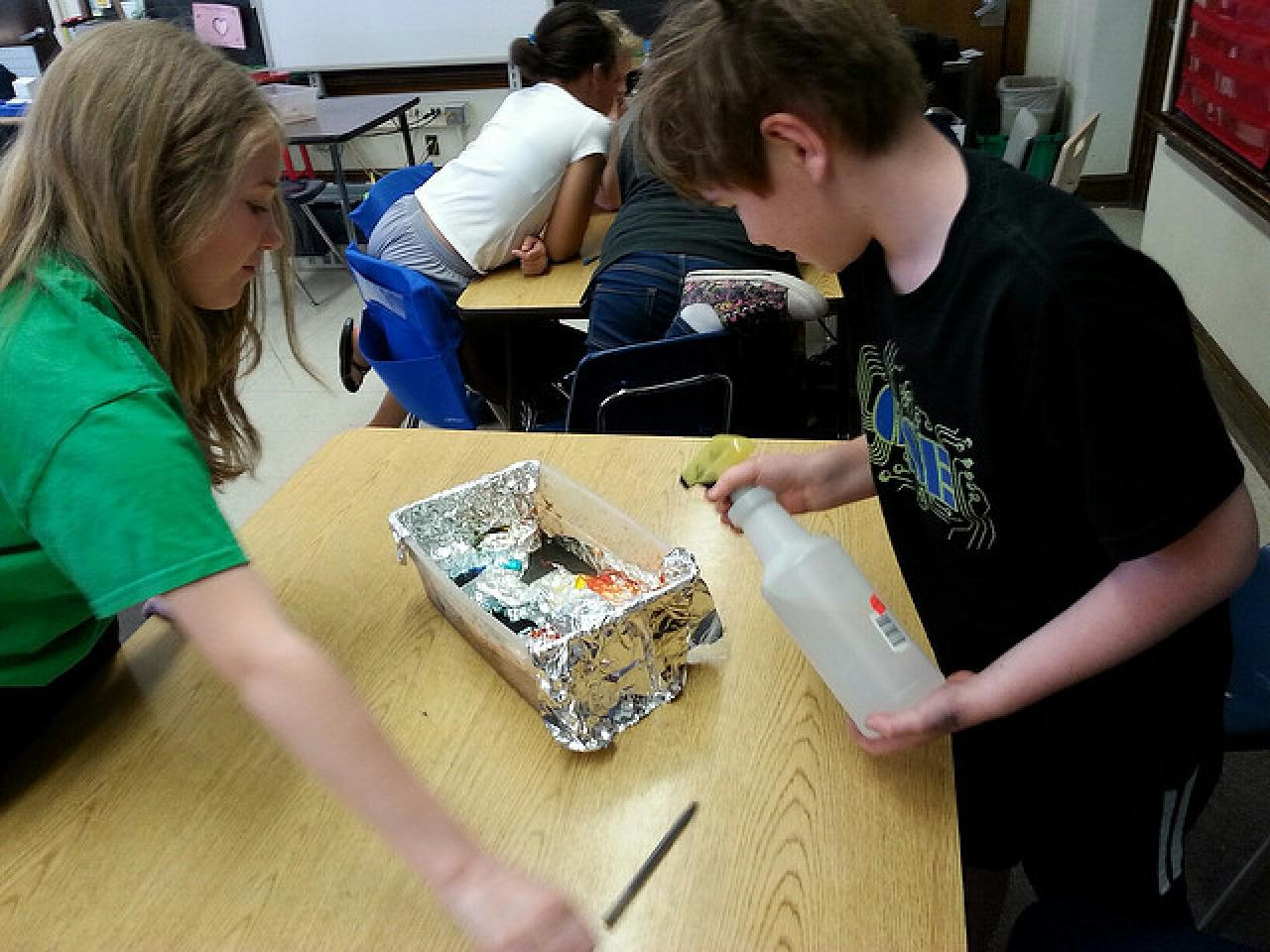 Dowling students explore watersheds using models and spray bottles