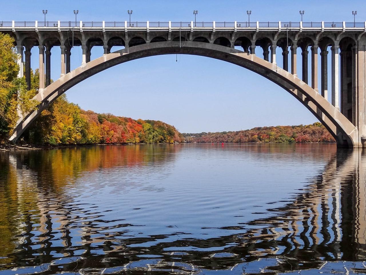 Mississippi River flows below bridge.