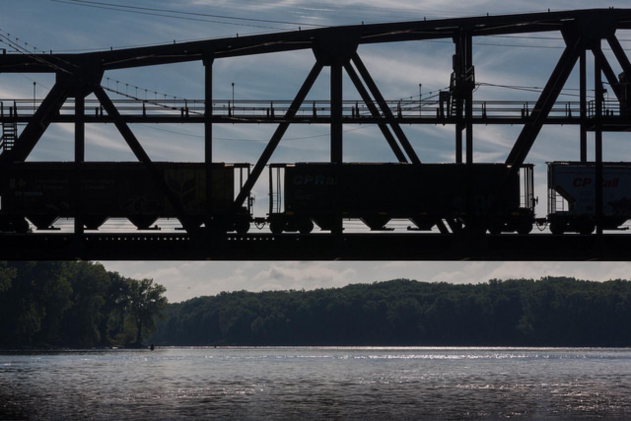 Train silhouette over the river in Hastings by Tom Reiter