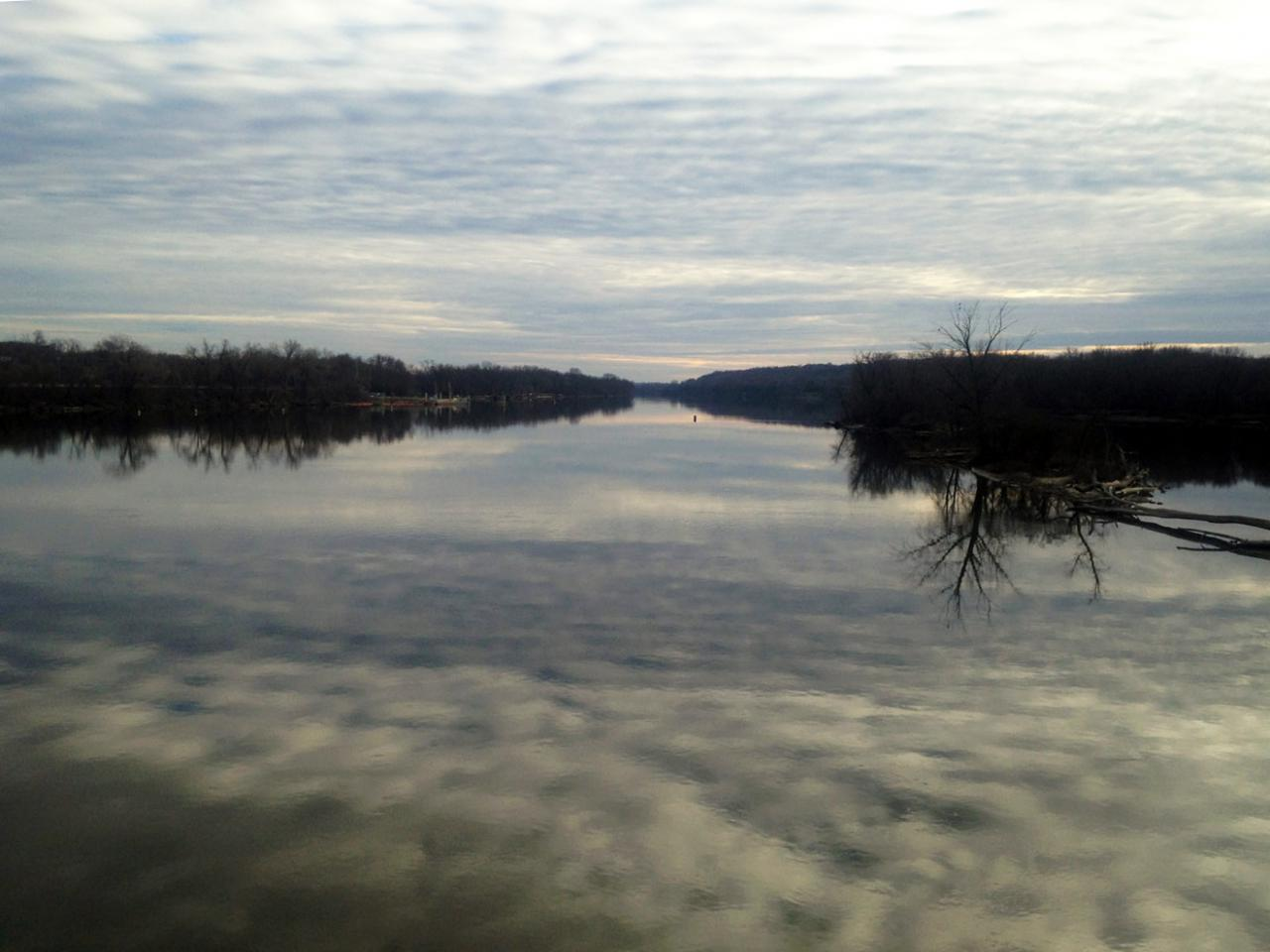 Clouds reflect on river's surface, by Bill Lindeke