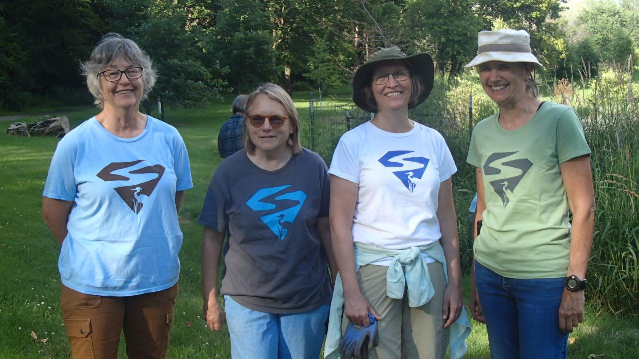 Four different versions of the SuperVolunteer shirt on display at the 2019 Crosby Farm Park tending