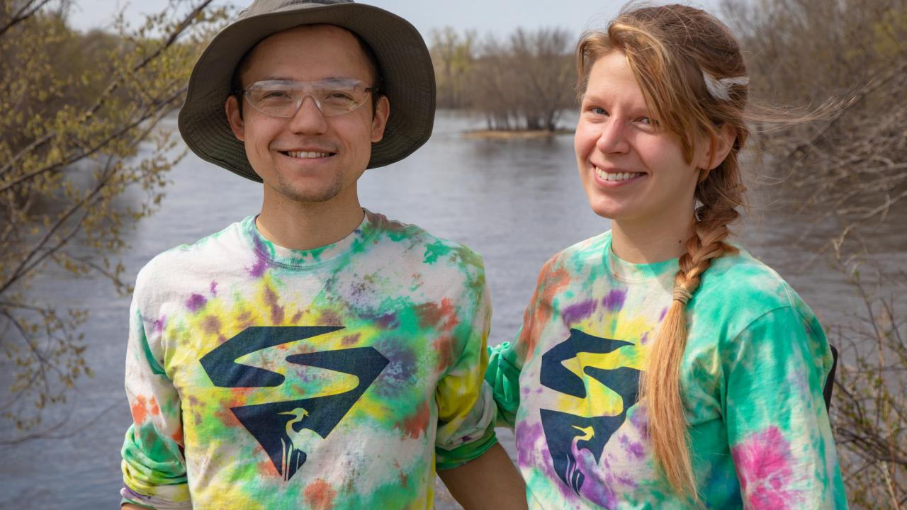 SuperVolunteers Allan and Stacy show off their true colors in front of the river.
