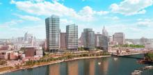 A drawing of the proposed Riversedge project. Four large towers rise above the Mississippi River between Shepard Road and Kellogg Boulevard.