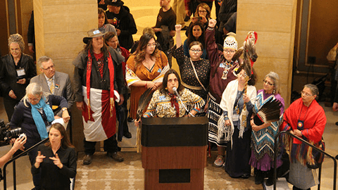 Winona La Duke surrounded by Minnesotans who want to protect our water in the capitol rotunda