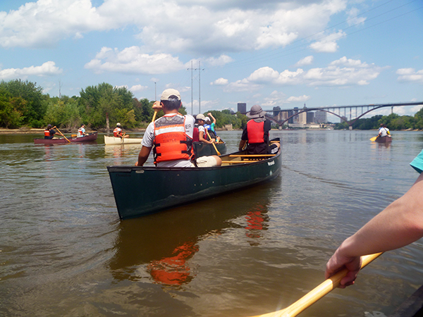 Youth Empowerment Program participants canoe the Mississippi